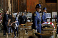 From left, Edwin W. Edwards' daughter Anna and his great granddaughter Zoe, 6, walk away from the casket as the former Louisiana Gov. lies in state in Memorial Hall of the Louisiana State Capitol in Baton Rouge, La., Saturday, July 17, 2021. The colorful and controversial four-term governor died of a respiratory illness on Monday, July 12. (AP Photo/Michael DeMocker)