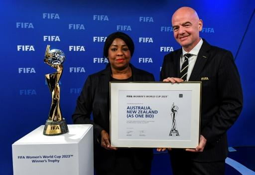 FIFA secretary general Fatma Samoura (L) and president Gianni Infantino appeared with the women's World Cup trophy after the decision was announced