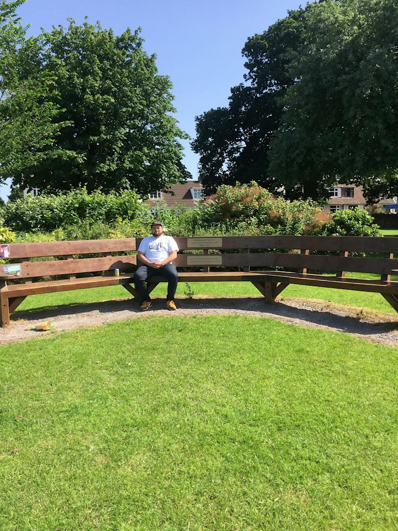 Sam Wilmot sitting on a bench in Downend, Bristol. (SWNS)