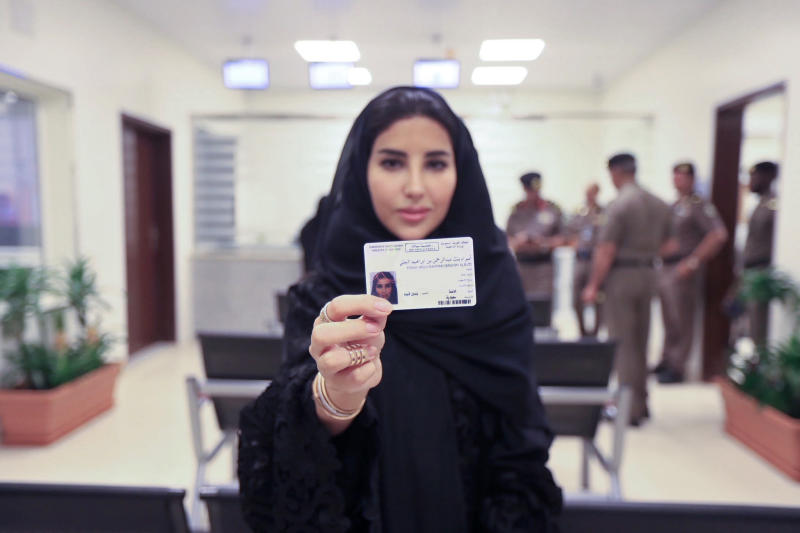 This image released by the Saudi Information Ministry, shows Esraa Albuti, an Executive Director at Ernst & Young, as she displays her brand new driving license, at the General Department of Traffic in the capital, Riyadh, Monday, June 4, 2018. Saudi Arabia has issued the first driving licenses to 10 women just weeks before the kingdom lifts the world's only ban on women driving, but the surprise move comes as a number of women who'd campaigned for the right to drive are under arrest. (Photos by Saudi Information Ministry via AP)