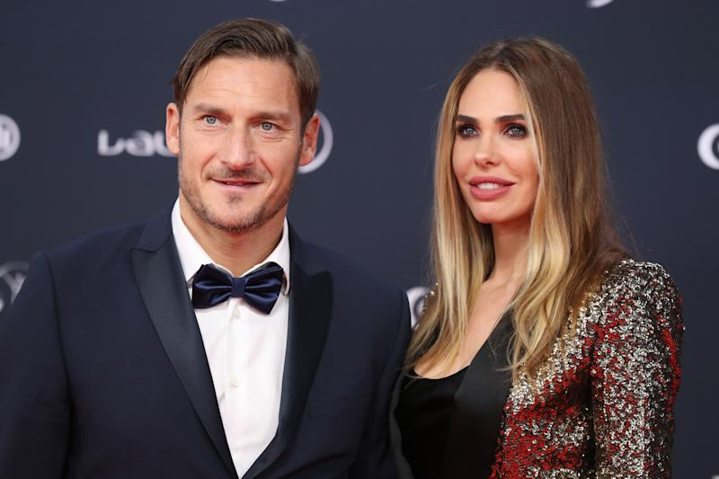 Former Italian football player Francesco Totti and his wife Italian TV host and model Ilary Blasi arrive for the 2018 Laureus World Sports Awards ceremony at the Sporting Monte-Carlo complex in Monaco on February 27, 2018. / AFP PHOTO / VALERY HACHE (Photo credit should read VALERY HACHE/AFP/Getty Images)