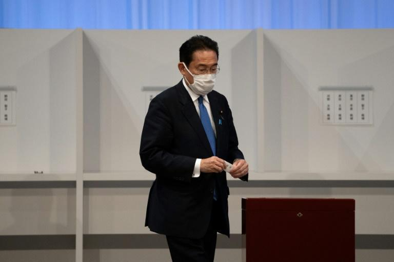 Kishida sought to capitalise on public discontent over Suga's response to the pandemic (AFP/Carl Court)