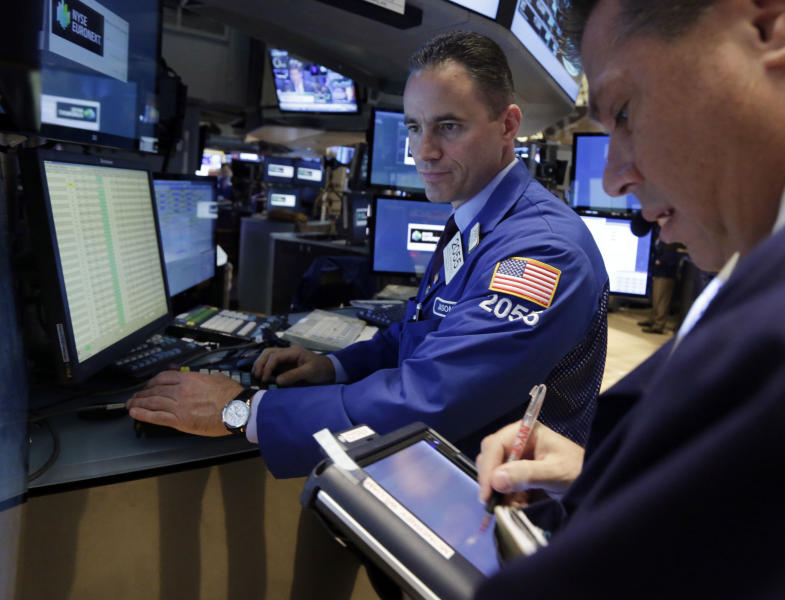 Specialist Jason Hardzewicz, left, works with traders at his post on the floor of the New York Stock Exchange Wednesday, July 10, 2013. Stocks nudged higher in early trading Wednesday before the Federal Reserve releases minutes from its most recent meeting. (AP Photo/Richard Drew)