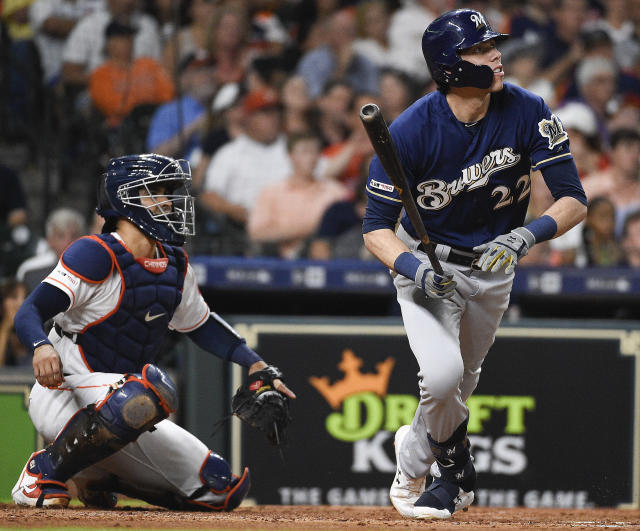 Milwaukee Brewers' Christian Yelich, right, watches his solo home run off Houston Astros starting pitcher Brad Peacock during the third inning of a baseball game, Tuesday, June 11, 2019, in Houston. (AP Photo/Eric Christian Smith)
