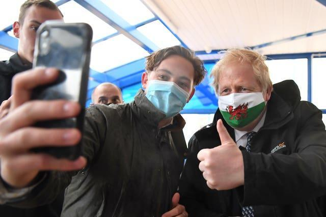 Prime Minister Boris Johnson poses for a photo during a visit to Marco's Cafe in Barry Island, Vale of Glamorgan, as part of the Welsh Conservative Party's Senedd election campaign