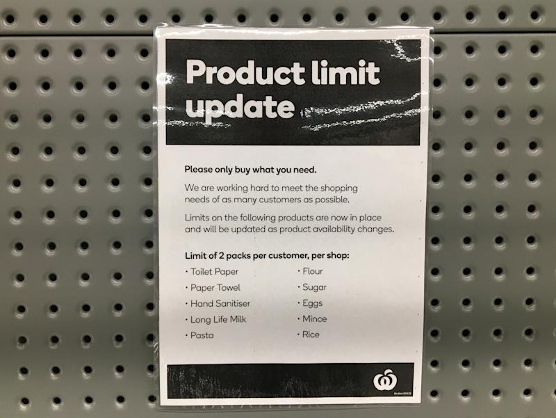 Signage for product limits is seen on a shelf in a Woolworths Supermarket in Melbourne.