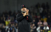 Liverpool's manager Jurgen Klopp applauds to supporters at the end of the English Premier League soccer match between Brentford and Liverpool at the Brentford Community Stadium in London, Saturday, Sept. 25, 2021. (AP Photo/Rui Vieira)