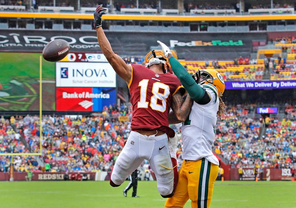 <p>Green Bay Packers defensive back Davon House, right, breaks up a pass intended for Washington Redskins wide receiver Josh Doctson (18) during the first half of an NFL football game , Sunday, Sept. 23, 2018 in Landover, Md. (AP Photo/Carolyn Kaster) </p>