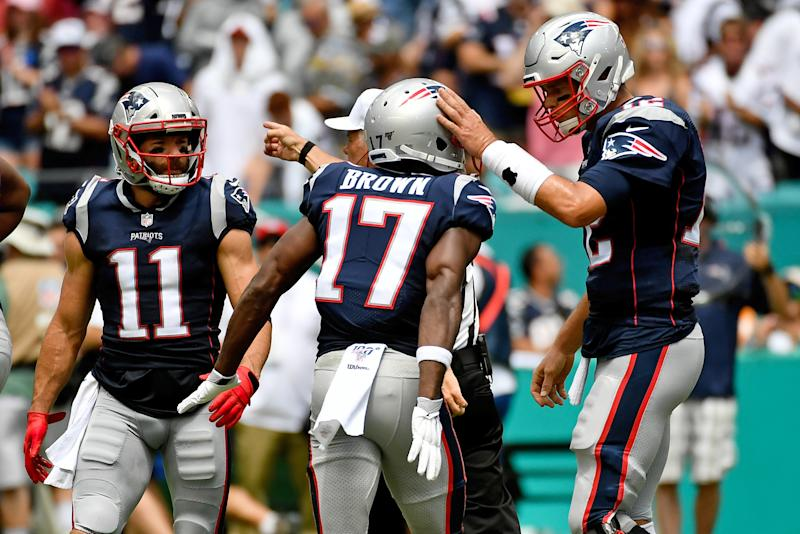 Sep 15, 2019; Miami Gardens, FL, USA; New England Patriots quarterback Tom Brady (12) congratulates wide receiver Antonio Brown (17) during the first half against the Miami Dolphins at Hard Rock Stadium. Mandatory Credit: Jasen Vinlove-USA TODAY Sports