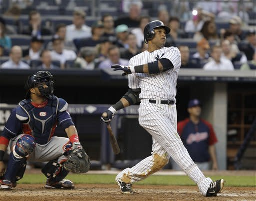 New York Yankees' Robinson Cano watches his third-inning solo home run off Cleveland Indians starting pitcher Josh Tomlin during a baseball game at Yankee Stadium in New York, Monday, June 25, 2012. It was Cano's second home run of the night. At left is Indians catcher Carlos Santana. (AP Photo/Kathy Willens)