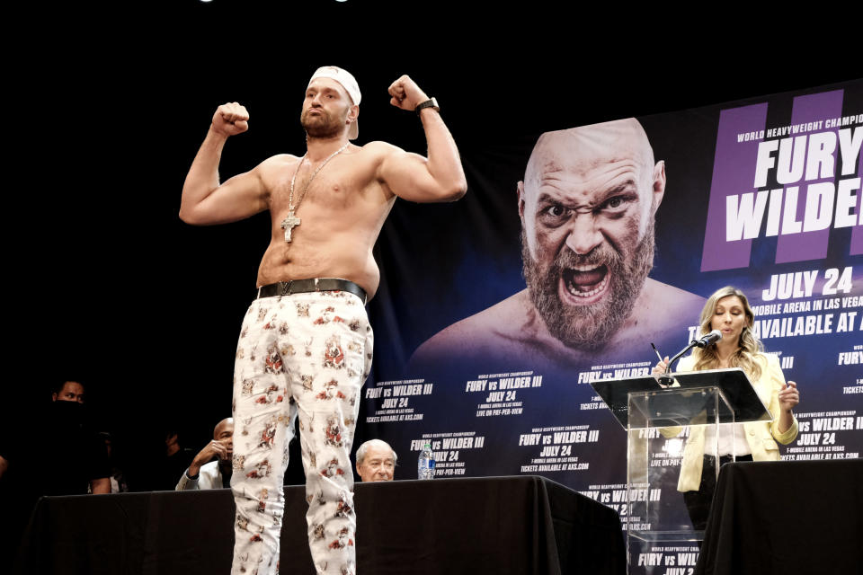 Tyson Fury poses during a news conference with Deontay Wilder in Los Angeles on Tuesday, June 15, 2021. The two are scheduled to fight in a heavyweight boxing bout July 24 in Las Vegas. (AP Photo/Richard Vogel)