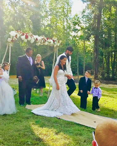 "<p>""Yesterday was magical,"" she captioned an Instagram pic that showed her and her new husband walking down the aisle after exchanging wedding vows. Evans's sons from previous relationships —Jace Evans, 7, and Kaiser Griffith, 2 — could both be seen in the photo. As for that dress, the Martina Liana ""French-inspired"" lace gown cost a whopping $2,999. Thanks, MTV! (Photo: <a rel=""nofollow"" href=""https://www.instagram.com/p/BZbolJWA_CX/?hl=en&taken-by=j_evans1219"">Jenelle Evans via Instagram</a>) </p>"