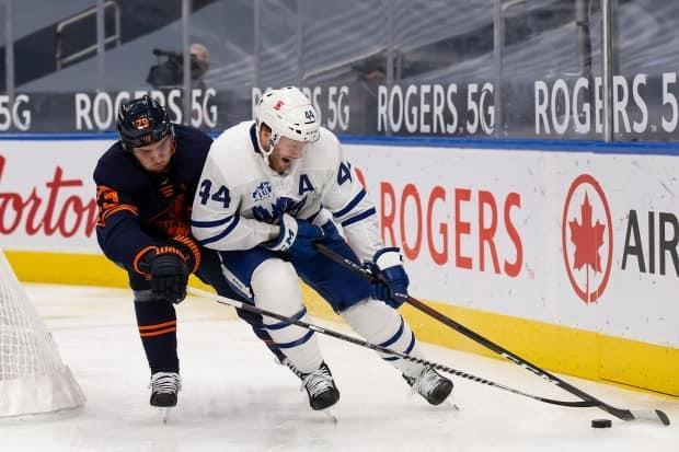 Leon Draisaitl, left, battles Toronto's Morgan Rielly during a game in January.