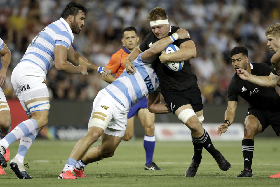 New Zealand's Sam Cane is tackled by the defence during the Tri-Nations rugby test between Argentina and the All Blacks in Newcastle, Australia, Saturday, Nov. 28, 2020. (AP Photo/Rick Rycroft)