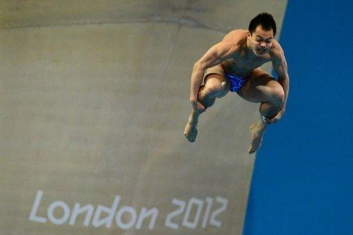China's He Chong competes in the men's 3m springboard final during the diving event at the London 2012 Olympic Games in London. He won the bronze medal