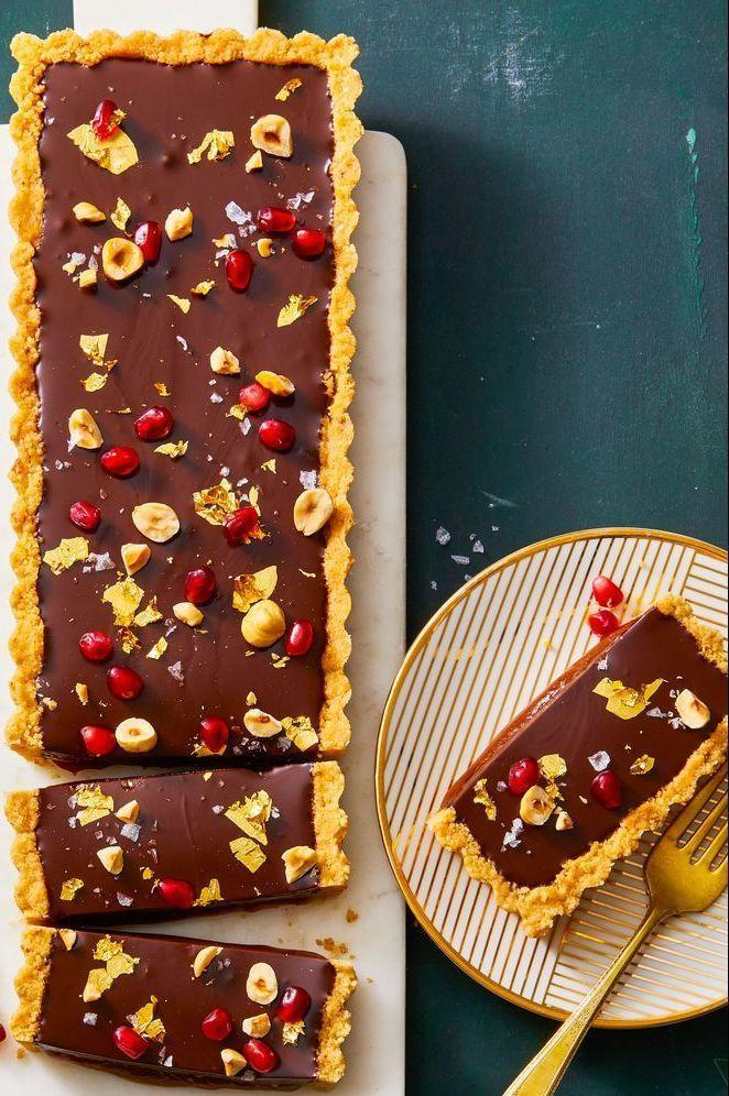 """<p>With gooey caramel, silky chocolate ganache and salty hazelnut crust, this tart lets all of your favorite dessert flavors shine.<br></p><p><a href=""""https://www.goodhousekeeping.com/food-recipes/a29658256/chocolate-hazelnut-and-caramel-tart-recipe/"""" rel=""""nofollow noopener"""" target=""""_blank"""" data-ylk=""""slk:Get the recipe for Chocolate, Hazelnut & Caramel Tart »"""" class=""""link rapid-noclick-resp"""">Get the recipe for Chocolate, Hazelnut & Caramel Tart »</a><br></p>"""