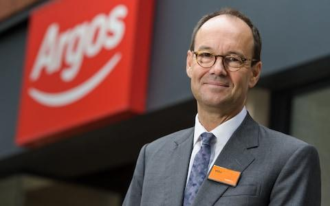 Mike Coupe, Sainsbury's boss, in front of an Argos store