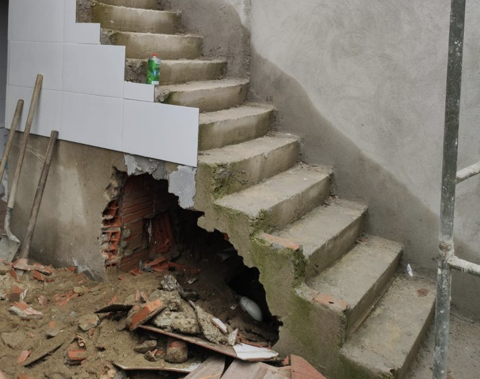 The hold under the staircase where the mum's body was found. Source: Australscope