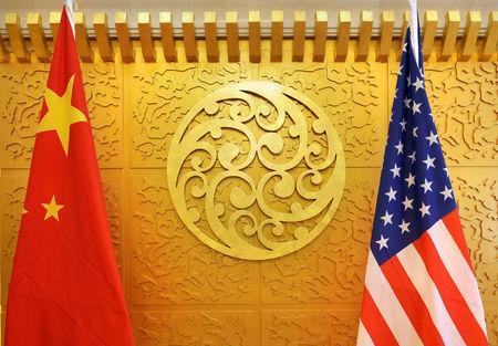 Chinese and U.S. flags are set up for a meeting during a visit by U.S. Secretary of Transportation Elaine Chao at China's Ministry of Transport in Beijing, China April 27, 2018. Picture taken April 27, 2018. REUTERS/Jason Lee