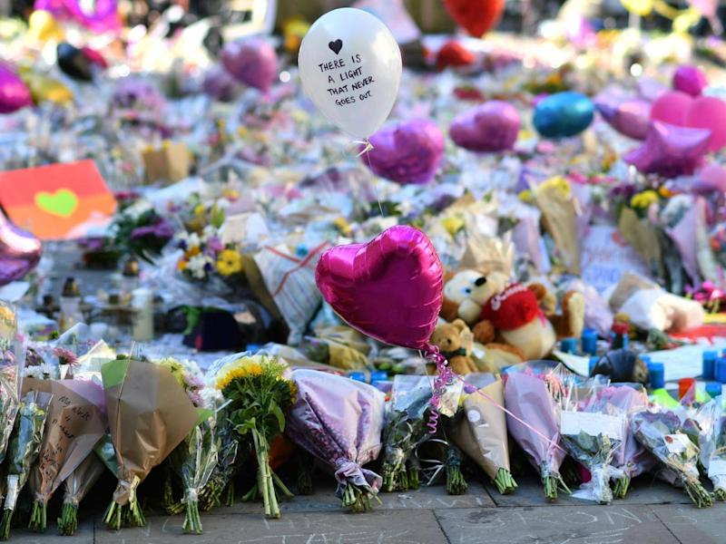 Manchester will stop on Tuesday to commemorate victims of the bombing (AFP/Getty)