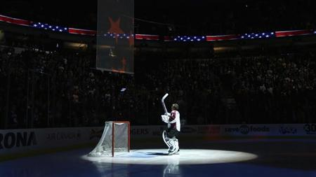 Colorado Avalanche goalie Varlamov stands for national anthems before their NHL hockey game against the Vancouver Canucks in Vancouver