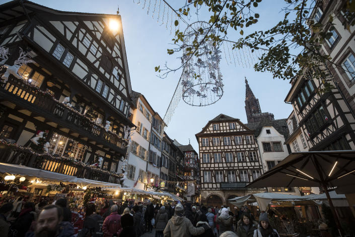 People once against in the streets as Strasbourg's Christmas market reopens under the protection of police, in Strasbourg, France, Saturday Dec. 15, 2018. French police shot and killed the man who they believed attacked Strasbourg's Christmas market on Tuesday killing four people. (AP Photo/Jean-Francois Badias)