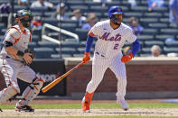 New York Mets' Dominic Smith (2) and Baltimore Orioles catcher Chance Sisco watch Smith's fifth-inning RBI double in a baseball game, Wednesday, May 12, 2021, in New York. (AP Photo/Kathy Willens)