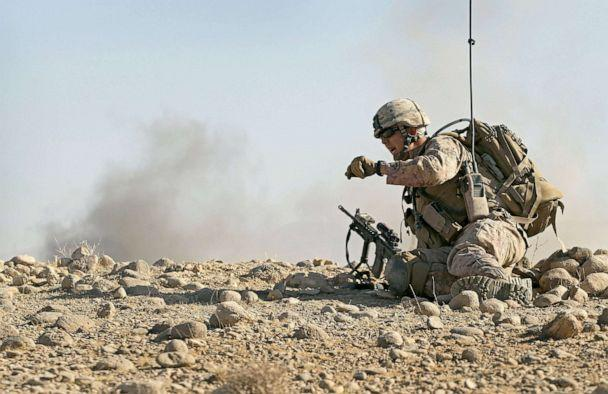 PHOTO: U.S. Marine attached to India Battery, 3rd Battalion watches dust and smoke fly as an artillery round is fired onto an enemy position during a firefight near Forward Operating Base (FOB) Zeebrugge, Oct. 9, 2010, near Kajaki, Afghanistan. (Scott Olson/Getty Images, FILE)