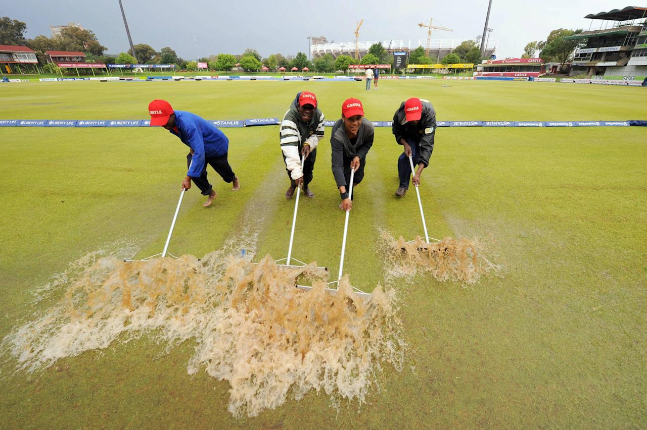 BLOEMFONTEIN, SOUTH AFRICA - NOVEMBER 21:  Ground staff attempt to clear rain water from the pitch during day three of the first test match between South Africa and Bangladesh held at the Outsurance Oval on November 21, 2008 in Bloemfontein, South Africa.  (Photo by Lee Warren/Gallo Images/Getty Images)