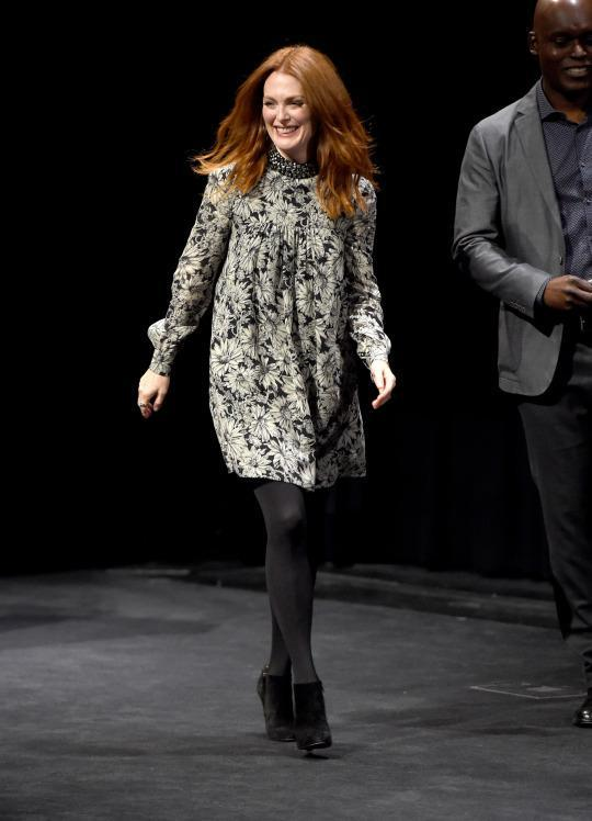 "<p>Julianne Moore took to the stage to talk about her new film ""Demolition"" in a floral turtleneck swing dress, black tights, and black booties.</p>"