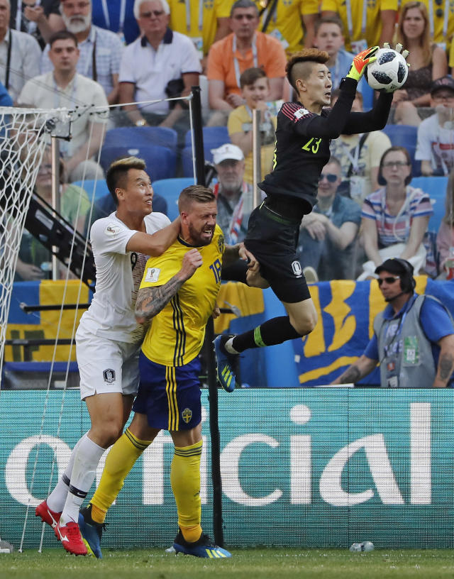 South Korea goalkeeper Jo Hyun-woo claims a cross during the group F match between Sweden and South Korea at the 2018 soccer World Cup in the Nizhny Novgorod stadium in Nizhny Novgorod, Russia, Monday, June 18, 2018. (AP Photo/Pavel Golovkin)