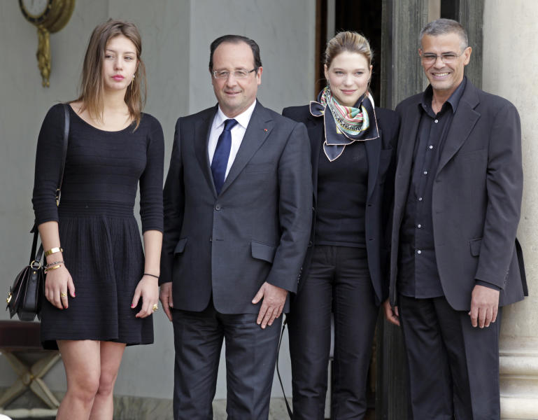 French President Francois Hollande, center left, poses for photographers with Tunisian film director Abdellatif Kechiche, right, and French actresses Adele Exarchopoulos, left, and Lea Seydoux prior to a lunch at the Elysee Palace, in Paris, Wednesday June 26, 2013. Abdellatif Kechiche directed the 2013 Palme d'Or winning film 'La vie d'Adele' and starred Adele Exarchopoulos and Lea Seydoux. (AP Photo/Remy de la Mauviniere)