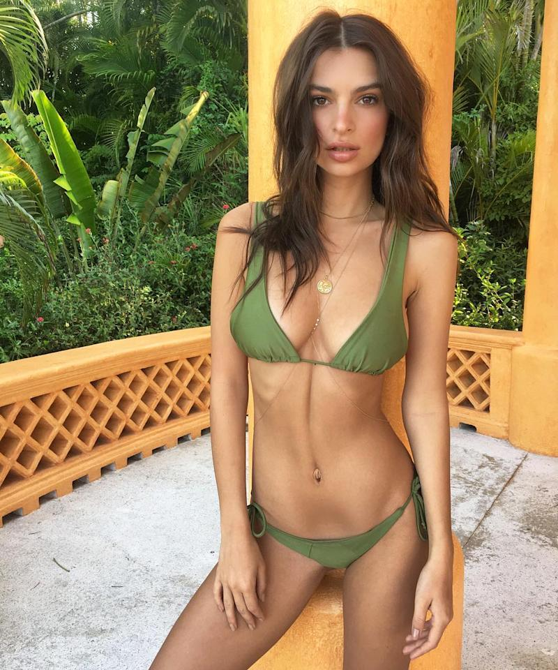 """<p>The actress bid us good morning from Mexico, posting this on-fire, green bikini shot to Instagram. She finished off the look with a sexy body chain (get a similar one <a rel=""""nofollow"""" href=""""http://www.anrdoezrs.net/links/7799179/type/dlg/sid/ISEmRataBikini3.20JA/http://www.revolve.com/luv-aj-evil-eye-bodychain/dp/LUVA-WL317/?d=Womens&page=1&lc=2&itrownum=1&itcurrpage=1&itview=01"""">here</a>) and a gold pendant necklace.</p>"""