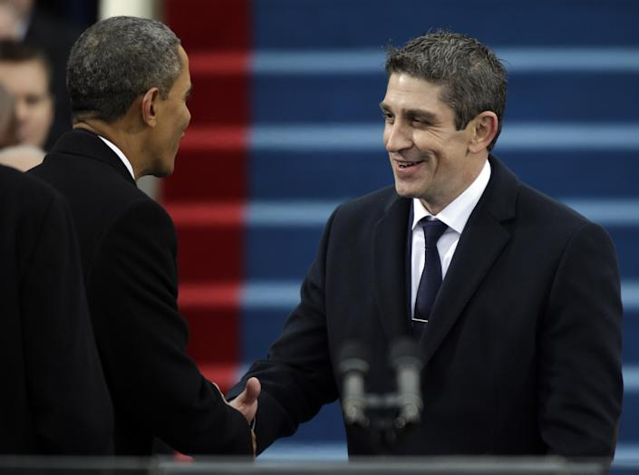 President Barack Obama, left, shakes hands with poet Richard Blanco during the ceremonial swearing-in West Front of the U.S. Capitol during the 57th Presidential Inauguration in Washington, Monday, Jan. 21, 2013. (AP Photo/Pablo Martinez Monsivais)