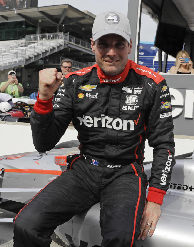 Will Power, of Australia, celebrates after winning the pole for the IndyCar Grand Prix auto race at Indianapolis Motor Speedway in Indianapolis, Friday, May 11, 2018. (AP Photo/Darron Cummings)