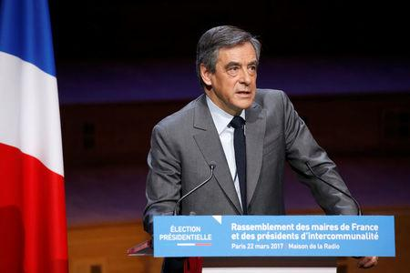 Francois Fillon, former French prime minister, member of the Republicans political party and 2017 presidential election candidate of the French centre-right, delivers his speech at the Association of the Mayors of France (AMF) conference in Paris, France, March 22, 2017. REUTERS/Charles Platiau