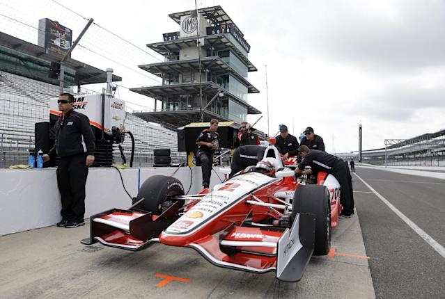 Former Indy 500 champion Juan Pablo Montoya, of Colombia, sits in his car during testing for the inaugural Grand Prix of Indianapolis auto race on the new road course at Indianapolis Motor Speedway in Indianapolis, Wednesday, April 30, 2014. (AP Photo/Michael Conroy)