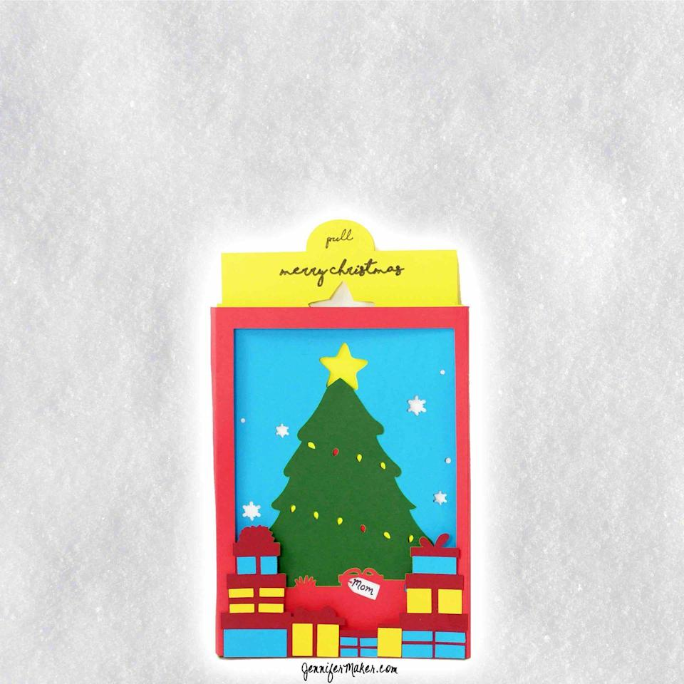 """<p>Use spray adhesive to assemble multiple layers of colorful paper. The end result: A beautiful multi-dimensional card that'll surely wow. </p><p><em>Get the tutorial at <a href=""""https://jennifermaker.com/christmas-tree-shadow-box-card/"""" rel=""""nofollow noopener"""" target=""""_blank"""" data-ylk=""""slk:Jennifer Maker"""" class=""""link rapid-noclick-resp"""">Jennifer Maker</a>.</em></p><p><a class=""""link rapid-noclick-resp"""" href=""""https://www.amazon.com/colored-Origami-colorful-Cardstock-Scrapbook/dp/B08CX6WRSX?tag=syn-yahoo-20&ascsubtag=%5Bartid%7C10072.g.34351112%5Bsrc%7Cyahoo-us"""" rel=""""nofollow noopener"""" target=""""_blank"""" data-ylk=""""slk:SHOP CARDSTOCK"""">SHOP CARDSTOCK</a></p>"""