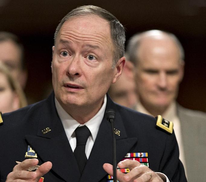 FILE - In this June 12, 2013 file photo, Gen. Keith B. Alexander, commander, U.S. Cyber Command and director, National Security Agency/Chief, Central Security Service testifies on Capitol Hill in Washington. Wondering what the U.S. government might know about your phone calls and online life? And whether all of this really helps find terrorists? Good luck finding solid answers. Americans trying to wrap their minds around two giant surveillance programs are confronted with a mishmash of leaks, changing claims and secrecy. Congress members complain their constituents are baffled _ and many lawmakers admit they are, too. (AP Photo/J. Scott Applewhite, File)
