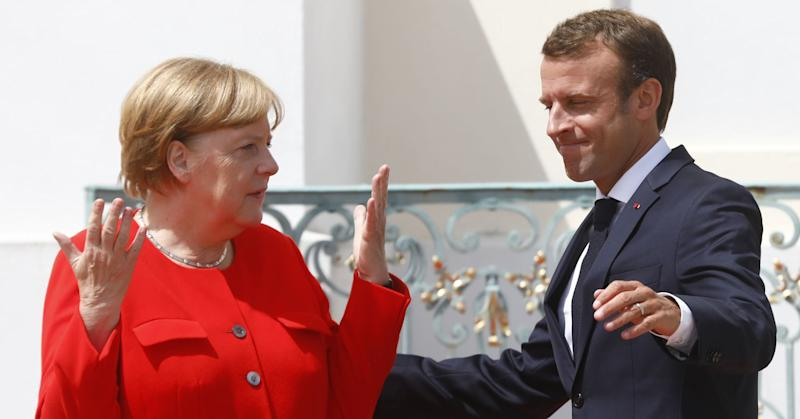 German Chancellor Angela Merkel greets French President Emmanuel Macron at Schloss Meseberg governmental palace during German-French government consultations on June 19, 2018 near Gransee, Germany.