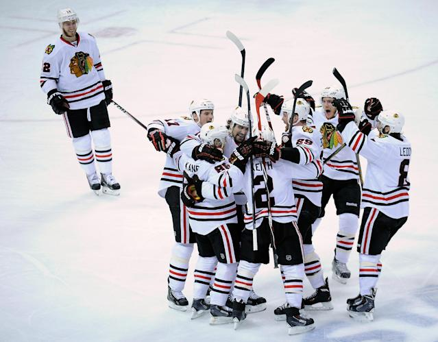 ST PAUL, MN - MAY 13: The Chicago Blackhawks celebrate a goal by Patrick Kane #88 against the Minnesota Wild during overtime in Game Six of the Second Round of the 2014 NHL Stanley Cup Playoffs on May 13, 2014 at Xcel Energy Center in St Paul, Minnesota. The Blackhawks defeated the Wild 2-1 in overtime. (Photo by Hannah Foslien/Getty Images)