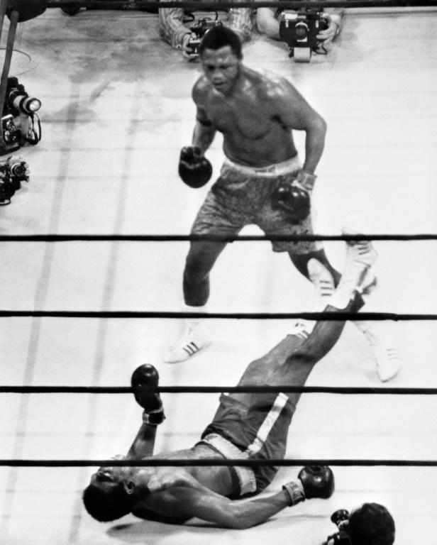 Joe Frazier had beaten Muhammad Ali in their first meeting, the 'Fight of the Century' in 1971 (AFP Photo/STR)