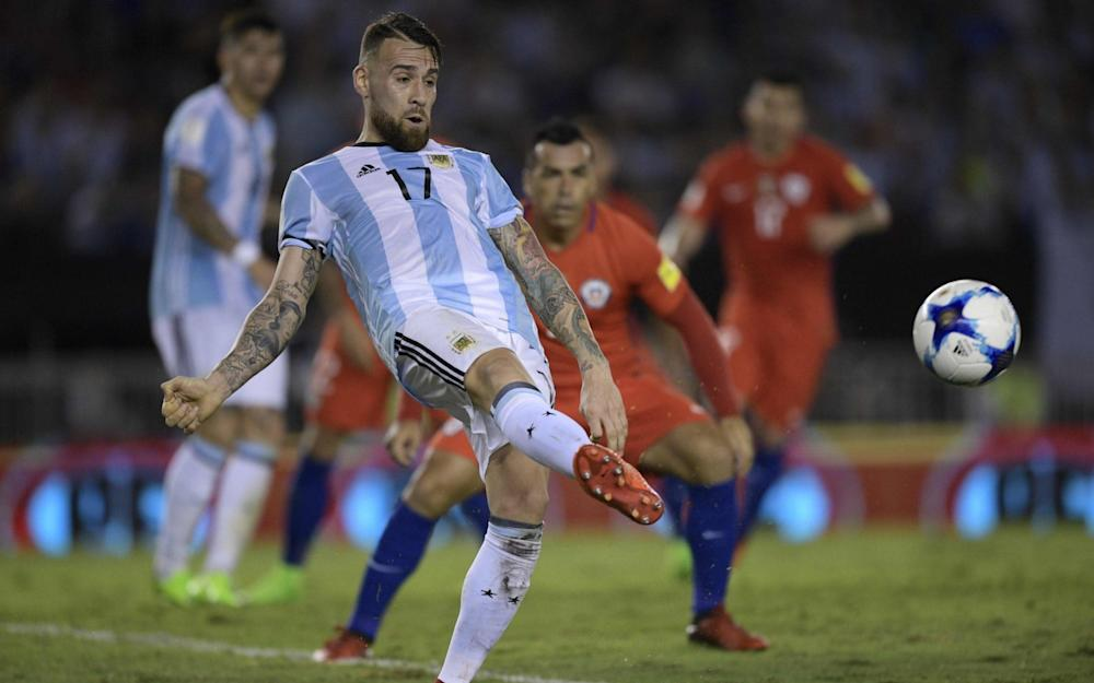 Argentina's Nicolas Otamendi shoots during their win against Chile - Credit: AFP
