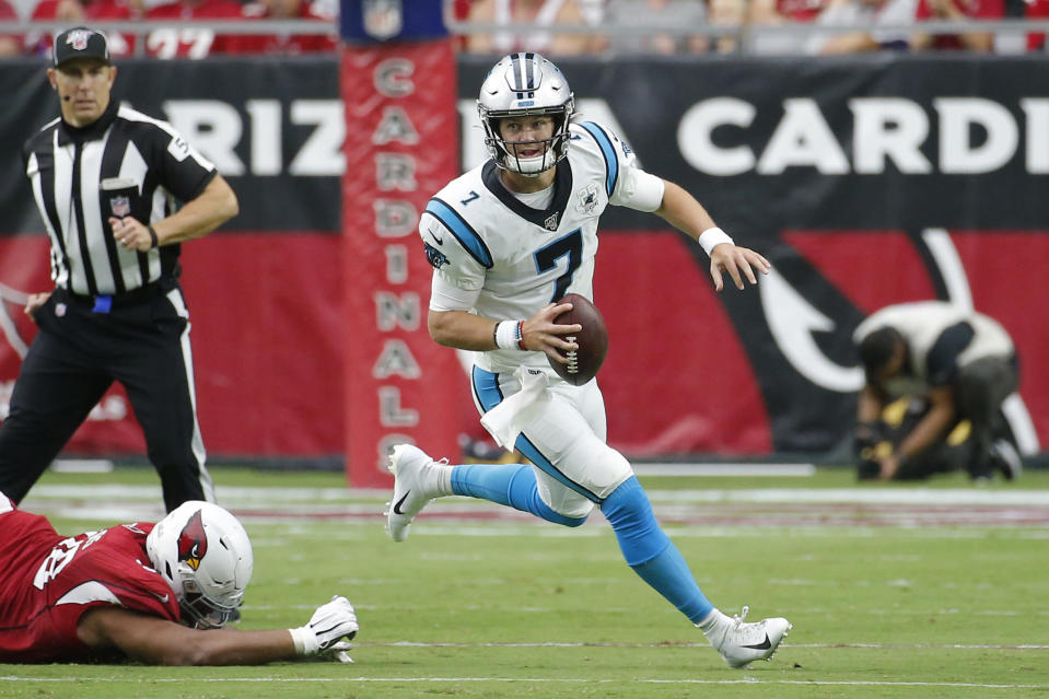 """FILE - In this Sunday, Sept. 22, 2019, file photo, Carolina Panthers quarterback Kyle Allen (7) rolls out during an NFL football game against the Arizona Cardinals in Glendale, Ariz. Allen said he knew he wasn't going to get drafted when he decided to turn pro after his junior season of college. But he added that he was OK with that and that he was willing to """"bet on myself,"""" confident he would make it in the NFL. (AP Photo/Rick Scuteri, File)"""