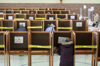 Voters cast their ballots at the St. Elizabeth of Hungary Parish Center in North Adams, Mass. on Tuesday, Nov. 3, 2020. (Gillian Jones/The Berkshire Eagle via AP)