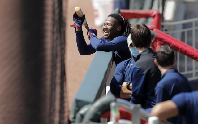 Atlanta Braves' Ronald Acua Jr., laughs in the dugout during team practice at Truist Park on Sunday, July 5, 2020, in Atlanta. (AP Photo/Brynn Anderson)