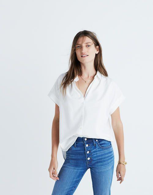 """<p><strong>Madewell</strong></p><p>madewell.com</p><p><strong>$65.00</strong></p><p><a href=""""https://go.redirectingat.com?id=74968X1596630&url=https%3A%2F%2Fwww.madewell.com%2Fcentral-shirt-in-pure-white-G0212.html&sref=https%3A%2F%2Fwww.goodhousekeeping.com%2Fholidays%2Fg32302046%2Ffourth-of-july-outfit-ideas%2F"""" rel=""""nofollow noopener"""" target=""""_blank"""" data-ylk=""""slk:Shop Now"""" class=""""link rapid-noclick-resp"""">Shop Now</a></p><p>Finding the right 4th outfit doesn't always need to be so complicated. Sometimes a simple white button up, a pair of blue jeans, and fun <a href=""""https://go.redirectingat.com?id=74968X1596630&url=https%3A%2F%2Fwww.madewell.com%2Fedge-detail-bandana-AL486.html&sref=https%3A%2F%2Fwww.goodhousekeeping.com%2Fholidays%2Fg32302046%2Ffourth-of-july-outfit-ideas%2F"""" rel=""""nofollow noopener"""" target=""""_blank"""" data-ylk=""""slk:red accessory"""" class=""""link rapid-noclick-resp"""">red accessory</a> is all you need! </p>"""