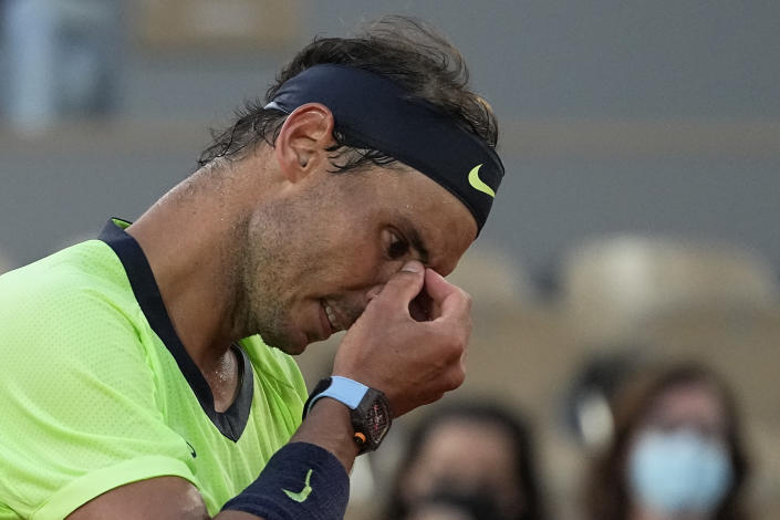 Spain's Rafael Nadal reacts as he plays Serbia's Novak Djokovic rduring their semifinal match of the French Open tennis tournament at the Roland Garros stadium Friday, June 11, 2021 in Paris. (AP Photo/Michel Euler)