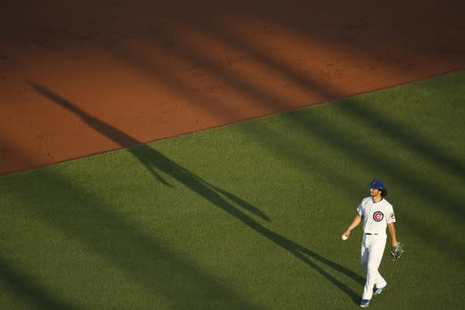 Chicago Cubs starting pitcher Yu Darvish walks around the mound after a strikeout during the third inning of a baseball game against the Milwaukee Brewers, Thursday, Aug. 13, 2020, in Chicago. (AP Photo/Jeff Haynes)