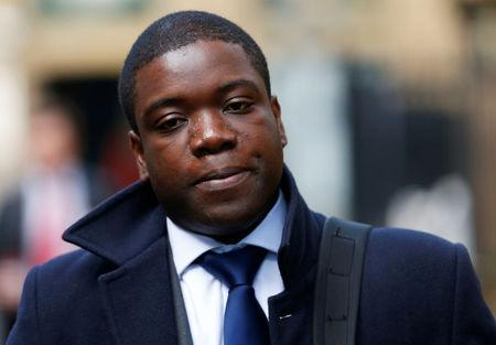 FILE PHOTO: Former UBS trader Kweko Adoboli arrives at Southwark Crown Court to attend his trial for fraud and false accounting in London